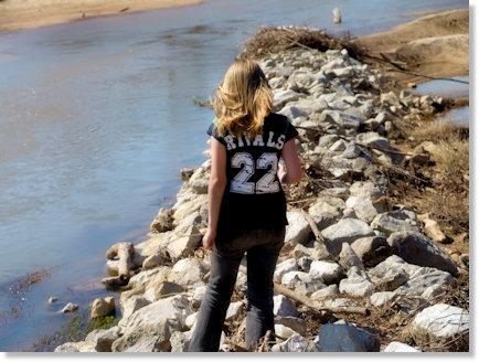 Haley walking on the rocks.